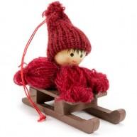 Karácsonyfadísz bordó kötött ruhás kisfiú szánkón 484347