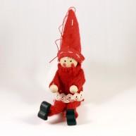IMP-EX karácsonyfadísz, figura ülő alakban csipkével díszített kötött kabátban